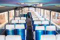 Coach bus interior of empty with blue seats Royalty Free Stock Photography