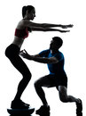 Coach man woman exercising squats on bosu Royalty Free Stock Photos