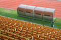 Coach and reserve benches with yellow seats Stock Images