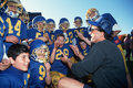Coach with youth football team Royalty Free Stock Photo