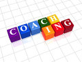 Coaching in color cubes text white letters on d different colors rainbow arranged business concept Royalty Free Stock Photography