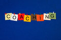 Coaching sign or poster for business life and mentoring in letters on noticeboard with pins Royalty Free Stock Images