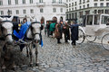 Coachmen have emotional conversation near the hors fiaker in a vintage dress horse drawn carts in vienna vienna attracts about Stock Images