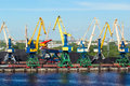 Coal cranes in port waiting for a ship to load a cargo Royalty Free Stock Images