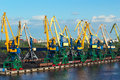 Coal cranes in port waiting for a ship to load a cargo Stock Photography