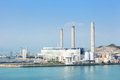 Coal fired power plant besides the sea Stock Photo