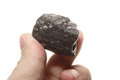 Coal lump carbon nugget in male hand isolated on white power and energy source Stock Photos