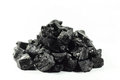 Coal lumps of on a white background Stock Photography