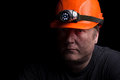 Coal miner on a black background Royalty Free Stock Photography