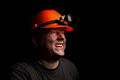 Coal miner on a black background Stock Photos