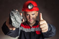 Coal miner with lump of coal Royalty Free Stock Photo