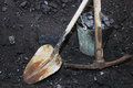 Coal mining. Shovel with a pickaxe and the bucket in mine Royalty Free Stock Photo