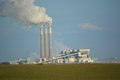 Coal Power Plant Emits Carbon Dioxide from Smoke Stacks Royalty Free Stock Photo