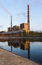 Coal power plant with reflection at dusk, industrial landscape. Royalty Free Stock Photo