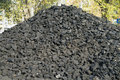 Coal stock washed and dried in a pile in the warehouse waiting for sale Stock Image