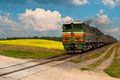 Coal train heavy freight fill with and country road landscape Royalty Free Stock Image