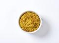 Coarse mustard bowl of grain Royalty Free Stock Photo