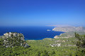 Coast of the aegean sea rhodes island greece scenic view and castle monolithos Royalty Free Stock Photos
