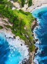 Coast as a background from top view. Turquoise water background from top view. Summer seascape from air. Bali island, Indonesia. Royalty Free Stock Photo
