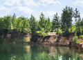 Coast forest lake with crystal clear water, which reflects the trees, beautiful prorodny landscape blue sky Royalty Free Stock Photo