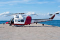 Coast guard helicopter waiting for passengers on sea dock Royalty Free Stock Image
