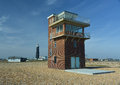 Coast guard look out tower dungeness uk the former on the beach at kent overlooking the english channel this has now been Stock Photo