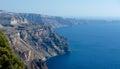 Coast of the island of santorini steep tower over mediterranean sea as an impregnable wall Royalty Free Stock Photo