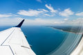 Coast through plane window brazil Royalty Free Stock Photography