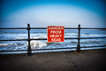Coastal danger sign Royalty Free Stock Photo