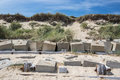 Coastal erosion management with concrete blocks. Sea defenses in Royalty Free Stock Photo