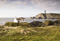 Coastal landscape with chapel and lighthouse Stock Photo