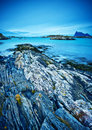 Coastal landscape a rugged rocks and blue sea Royalty Free Stock Image