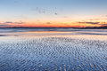 Coastal mud flats texture background nature on folly beach near charleston south carolina at sunset Stock Photography