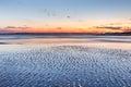 Coastal mud flats texture background nature on folly beach near charleston south carolina at sunset Stock Photography