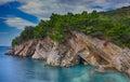 Coastal rocks with pine trees Royalty Free Stock Photo