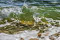 Coastal transparent sea/ocean crashing wave with foam on its top