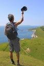Coastal wanderer sway his cap back view Stock Photo