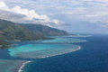 Coastline of moorea french polynesia surrounded by coral reefs Stock Photo