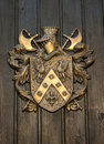Coat of arms on old plank wood door Royalty Free Stock Image