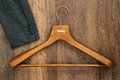 Coat hanger with suit on wood board laundry shop business concep Royalty Free Stock Photo