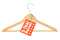 Coat hanger with warranty tag isolated on white background Stock Photo