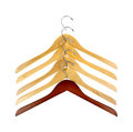 Coat hangers sturdy wood dark offset a group of five Royalty Free Stock Photography