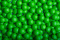 Coated green candy background of Stock Photos