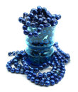 Cobalt blue freshwater pearls in drinking glass Royalty Free Stock Photo