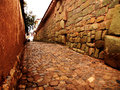Cobble street cusco ancient inca stone wall and in peru Stock Image