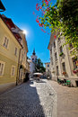 Cobbled old street and church of Ljubljana Royalty Free Stock Photo
