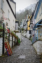 Cobbled street in english village this narrow climbs up a steep hill at clovelly devon england the houses and cottages are Stock Photo
