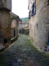 Cobbled street in france peaceful french with lamp and shutters and old crumbling walls Royalty Free Stock Image