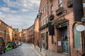 Cobbled Street Lined with Brick Buildings Royalty Free Stock Photo