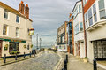 Cobbled Street lined with Renovated Buildings Royalty Free Stock Photo